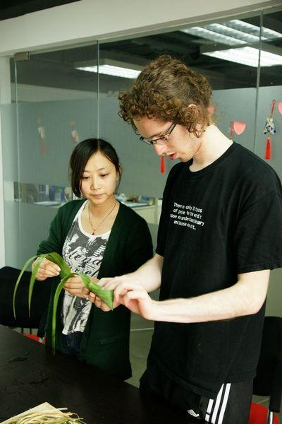 A student from Austria learning how to wrap a Zongzi